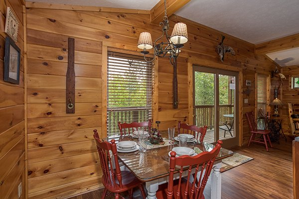 Dining room table with seating for four at Bird's Eye View, a 2-bedroom cabin rental located in Gatlinburg