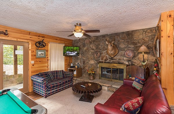 Game room with a couch and loveseat at Bird's Eye View, a 2-bedroom cabin rental located in Gatlinburg