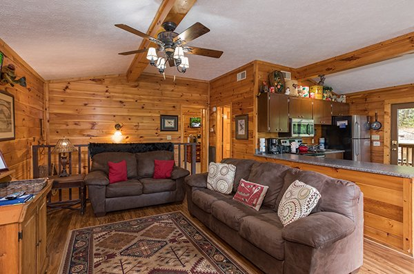 Living room with sofa and loveseat at Bird's Eye View, a 2-bedroom cabin rental located in Gatlinburg