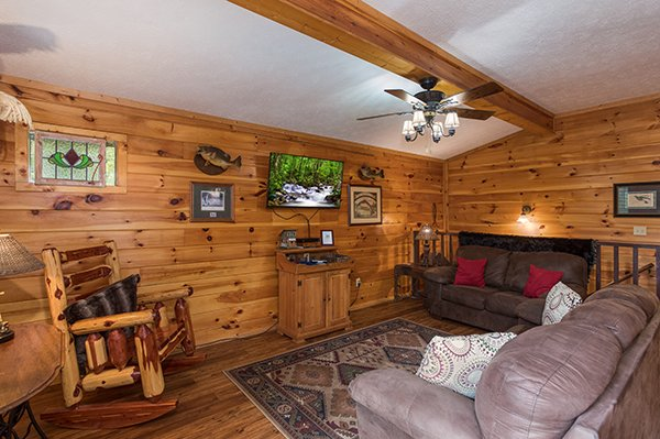 Wall-mounted television in the living room at Bird's Eye View, a 2-bedroom cabin rental located in Gatlinburg