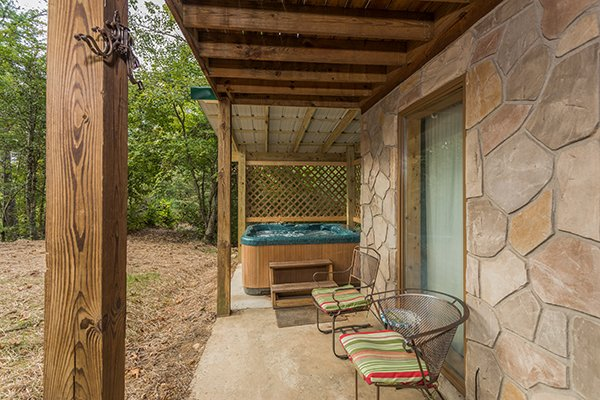 Patio with two chairs and a hot tub at Bird's Eye View, a 2-bedroom cabin rental located in Gatlinburg