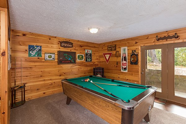 Green felted pool table at Bird's Eye View, a 2-bedroom cabin rental located in Gatlinburg