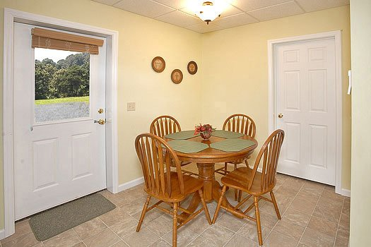 Dining table for four at Heaven Sent, a 2-bedroom cabin rental located in Pigeon Forge