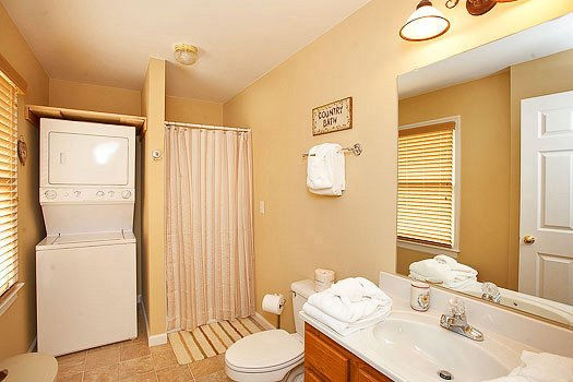 En suite bath with washer and dryer at Heaven Sent, a 2-bedroom cabin rental located in Pigeon Forge