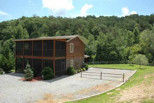 Gravel parking area at Heaven Sent, a 2-bedroom cabin rental located in Pigeon Forge