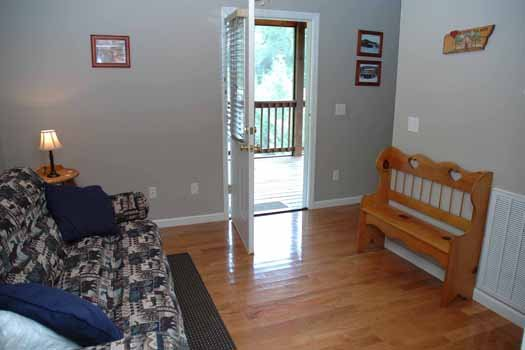 Screened deck access from second floor at Heaven Sent, a 2-bedroom cabin rental located in Pigeon Forge