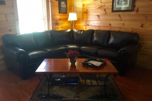 Sectional sofa in the living room at Heaven Sent, a 2-bedroom cabin rental located in Pigeon Forge