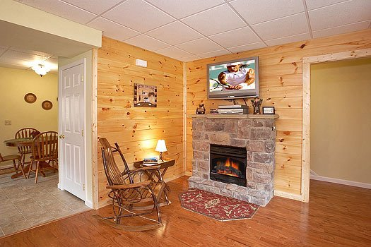 stone fireplace in the living room at heaven sent a 2 bedroom cabin rental located in pigeon forge
