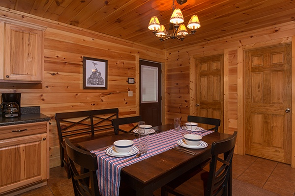 Dining space for four at Rustic Romance, a 2 bedroom cabin rental located in Pigeon Forge
