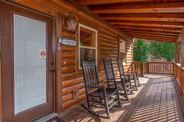 Front porch with rocking chairs at Rustic Romance, a 2 bedroom cabin rental located in Pigeon Forge