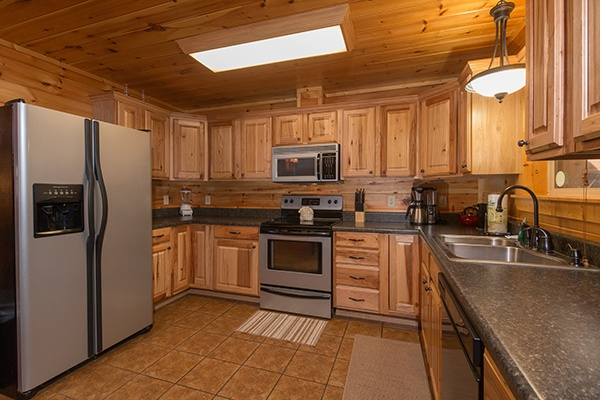Kitchen with stainless appliances at Rustic Romance, a 2 bedroom cabin rental located in Pigeon Forge