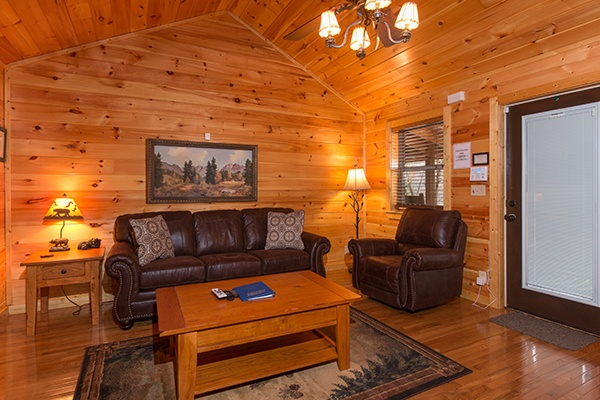Living room with sofa and chair at Rustic Romance, a 2 bedroom cabin rental located in Pigeon Forge