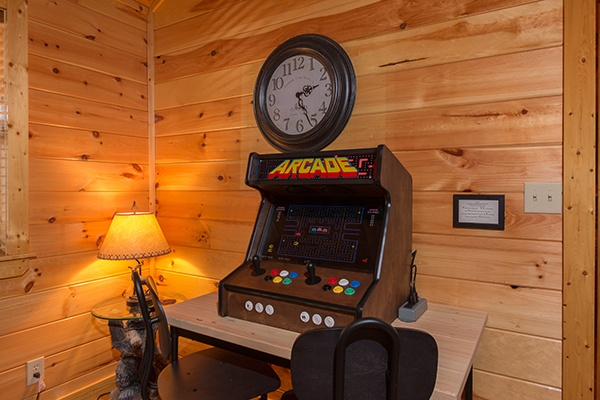 Table top arcade game in the living room at Rustic Romance, a 2 bedroom cabin rental located in Pigeon Forge