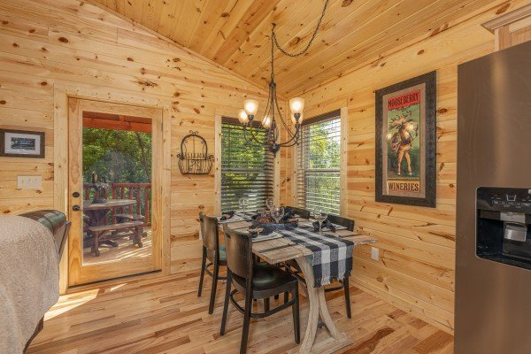 Dining table for four at Mountain Life, a 2 bedroom cabin rental located in Pigeon Forge
