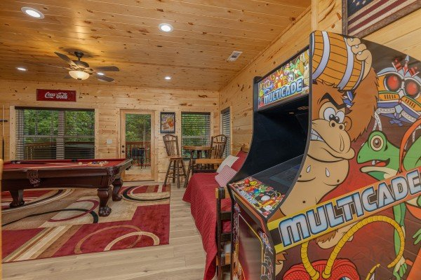 Game room with a pool table and arcade game at Mountain Life, a 2 bedroom cabin rental located in Pigeon Forge