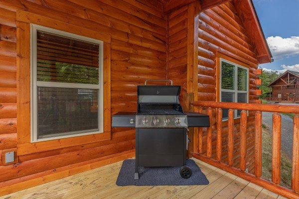 Grill on a covered deck at Mountain Life, a 2 bedroom cabin rental located in Pigeon Forge