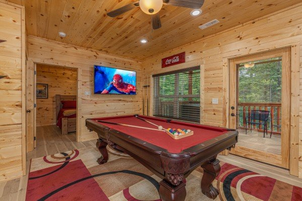 Pool table and TV in a game room at Mountain Life, a 2 bedroom cabin rental located in Pigeon Forge