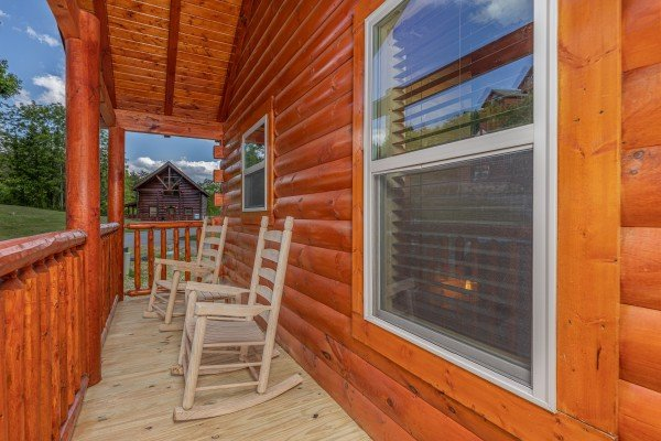 Rocking chairs on a covered deck at Mountain Life, a 2 bedroom cabin rental located in Pigeon Forge