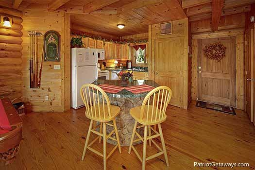 bar seating area at swept away a 1 bedroom cabin rental located in pigeon forge