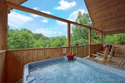covered deck with hot tub at swept away a 1 bedroom cabin rental located in pigeon forge