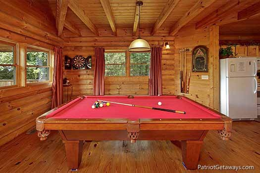 game area with pool table at swept away a 1 bedroom cabin rental located in pigeon forge