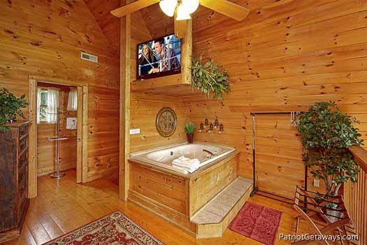 jacuzzi tub in bedroom at swept away a 1 bedroom cabin rental located in pigeon forge
