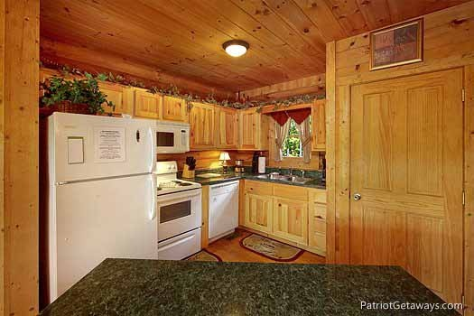 kitchen and bar at swept away a 1 bedroom cabin rental located in pigeon forge