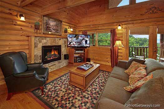 living room with fireplace at swept away a 1 bedroom cabin rental located in pigeon forge