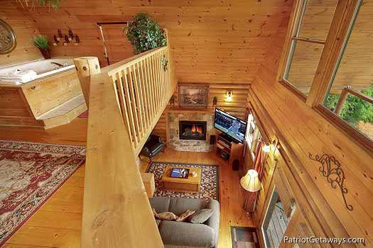 lofted bedroom with jacuzzi at swept away a 1 bedroom cabin rental located in pigeon forge