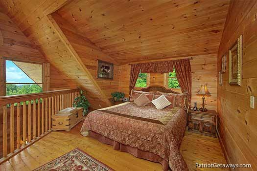 lofted bedroom with king bed at swept away a 1 bedroom cabin rental located in pigeon forge