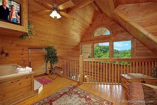 lofted king bedroom at swept away a 1 bedroom cabin rental located in pigeon forge