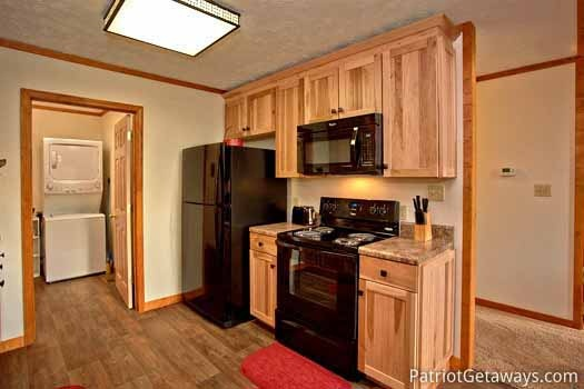Kitchen with black appliances at Cabin on the Hill, a 1-bedroom cabin rental located in Pigeon Forge