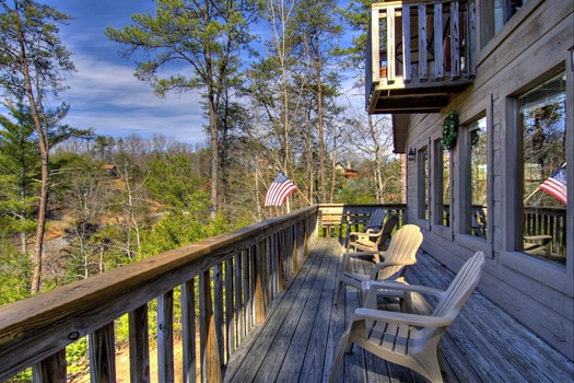 Chairs on the deck at Cabin on the Hill, a 1-bedroom cabin rental located in Pigeon Forge