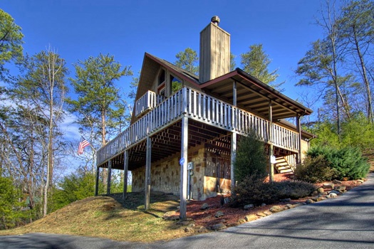 Wrap around deck at Cabin on the Hill, a 1-bedroom cabin rental located in Pigeon Forge
