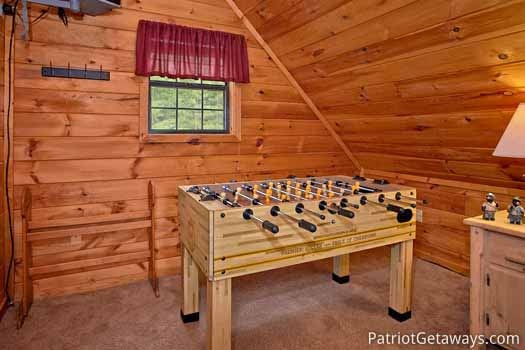 Foosball table in lofted bedroom at Cabin on the Hill, a 1-bedroom cabin rental located in Pigeon Forge