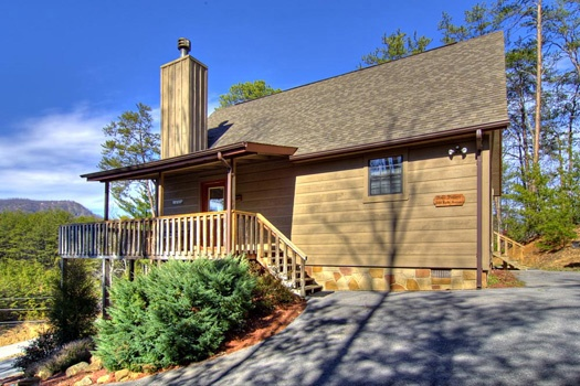 Front door angle of exterior of Cabin on the Hill, a 1-bedroom cabin rental located in Pigeon Forge