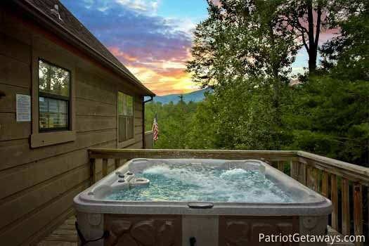 Sunset from the hot tub at Cabin on the Hill, a 1-bedroom cabin rental located in Pigeon Forge