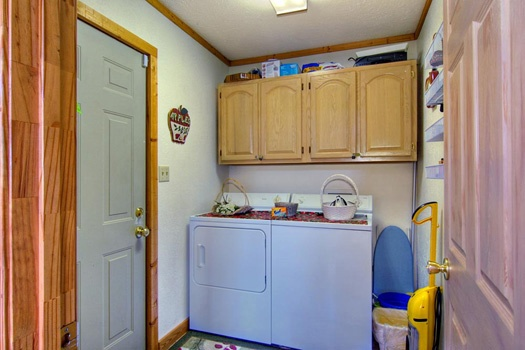 laundry room with washer and dryer at cabin on the hill a 1 bedroom cabin rental located in pigeon forge