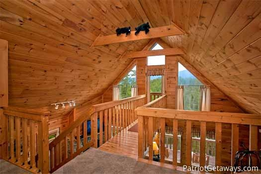 Loft walkway to deck at Cabin on the Hill, a 1-bedroom cabin rental located in Pigeon Forge