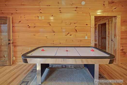 air hockey table in the game room at majestic mountain view a 2 bedroom cabin rental located in pigeon forge