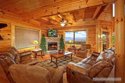 Cozy living room with stone fireplace in the corner at Majestic Mountain View, a 2 bedroom cabin rental located in Pigeon Forge