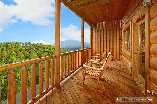 rockers on the deck facing the smoky mountains at majestic mountain view a 2 bedroom cabin rental located in pigeon forge