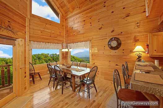 dining table at majestic mountain view a 2 bedroom cabin rental located in pigeon forge