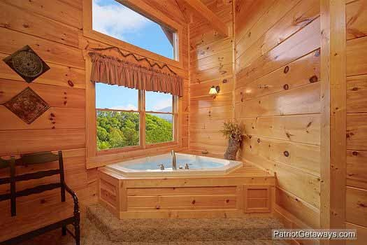 Jacuzzi tub in corner of bedroom at Majestic Mountain View, a 2 bedroom cabin rental located in Pigeon Forge