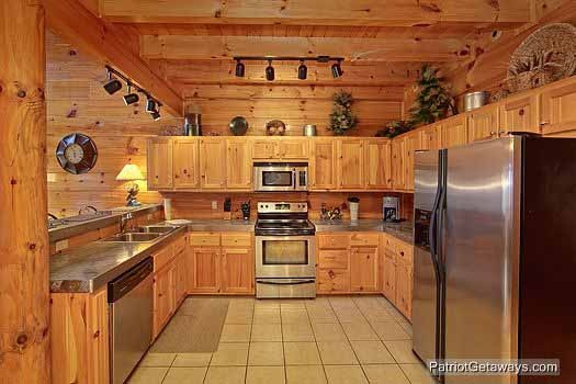 kitchen with stainless appliances at majestic mountain view a 2 bedroom cabin rental located in pigeon forge