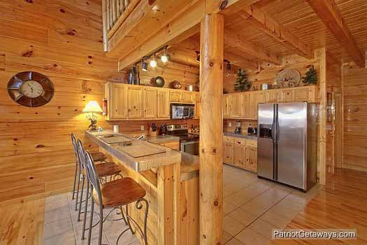 kitchen with breakfast bar at majestic mountain view a 2 bedroom cabin rental located in pigeon forge