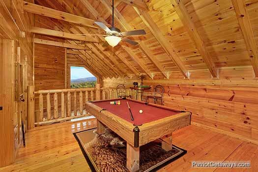 pool table in lofted game room at majestic mountain view a 2 bedroom cabin rental located in pigeon forge