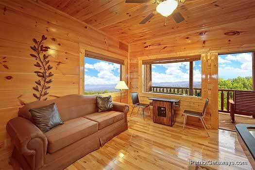 sofa bed in the game room at majestic mountain view a 2 bedroom cabin rental located in pigeon forge
