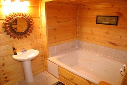 bathroom with jacuzzi tub at lazy rooster a 2 bedroom cabin rental located in gatlinburg