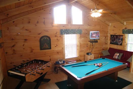 game room with pool table and foosball table at lazy rooster a 2 bedroom cabin rental located in gatlinburg